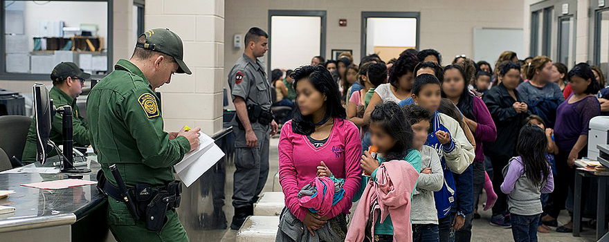 US Customs and Border Protection agents processing unaccompanied children, in Texas, at the border with Mexico, in 2014 [Hector Silva, USCBP–Wikimedia Commons]